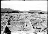 Excavated room, south side of plaza looking west, Puyé, New Mexico