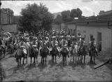 Group on horseback in Palace of the Governors courtyard during De Vargas Pageant, Santa Fe, New...