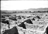 Excavated rooms to northwest across old plaza, Puyé, New Mexico