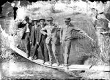 New Mexico Normal (Highlands) University students and Nesse Nusbaum standing on board planks near...