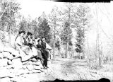 New Mexico Normal (Highlands) University students sitting on wall on road to El Porvenir, New...