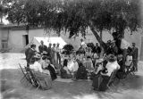 San Ildefonso Pueblo women demonstrating pottery making in the courtyard of the Palace of the...