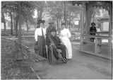 Crippled Episcopal minister in wheelchair, Plaza, Santa Fe, New Mexico