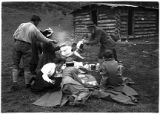 Group having lunch at ranger's camp in Santa Fe Canyon, New Mexico