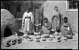 San Juan potters displaying their work, San Juan Pueblo, New Mexico