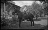 Woman on horseback, Young Ranch, New Mexico