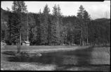 Unidentified cabin on pond, New Mexico