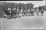 Group of riders at horse show, New Mexico
