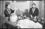 Navajo weavers preparing yarn, New Mexico