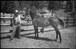 Unidentified man with horse, Jesus Baca Ranch, New Mexico