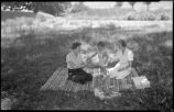 Women and child picnicking at Ghost Ranch near Abiquiu, New Mexico