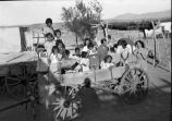 Group in wagon, Isleta Pueblo, New Mexico