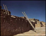 Row of adobe buildings at unidentified Pueblo, New Mexico