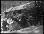 Packing a toboggan, Los Alamos Ranch School, Los Alamos, New Mexico