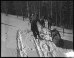 Skiers towing toboggan, Los Alamos Ranch School, Los Alamos, New Mexico