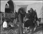 Navajo family and wagons at encampment, New Mexico