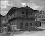 Two story adobe building in Ojo Caliente (?), New Mexico
