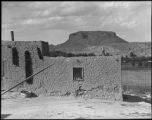 Adobe home with Black Mesa in background, San Ildefonso Pueblo, New Mexico