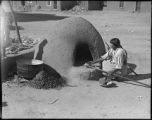 Baking bread in horno, Santa Clara Pueblo, New Mexico