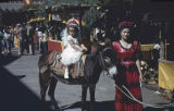 Young girl on burro during fiesta, Santa Fe, New Mexico