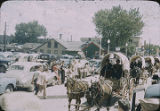 Parade of Navajo in wagons, New Mexico