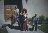 Children in fiesta costume with burros, Santa Fe, New Mexico