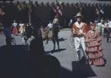 Couple in fiesta dress in front of Palace of the Governors, Santa Fe, New Mexico