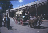 Covered wagon in front of Palace of the Governors during fiesta, Santa Fe, New Mexico