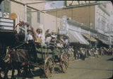 Horse drawn wagon float in parade, New Mexico