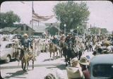 Large group of horseback riders at parade, New Mexico