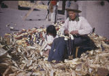 Man and child shucking corn, New Mexico