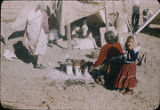 Woman cooking in camp, New Mexico