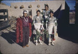 Man with Pueblo dancers, New Mexico