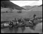 Los Alamos Ranch School students washing dishes and fishing in the Valle Grande near Los Alamos,...