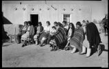 Helen Cordero with baby, Caroline Pecos fourth from left, Cochiti Pueblo, New Mexico