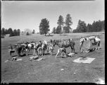 Los Alamos Ranch School students breaking camp near Los Alamos, New Mexico