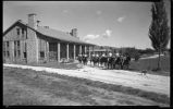 Students leaving Los Alamos Ranch School on horseback, Los Alamos, New Mexico