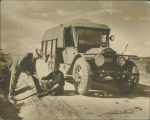 New Mexico Governor Richard Dillon (?) and man examining concho belt by United States Agency truck...