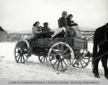 Family on Wagon in Snowstorm in Penasco, New Mexico