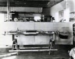 Dr. Goddard workshop, interior view, Henry Sachs with Rocket - Dec 22, 1930