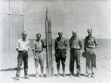 Dr. Goddard with rocket and crew - Sept 29, 1931