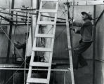 Dr. Goddard on ladder preparing for test - Sep 23, 1935