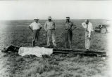Dr. Goddard and crew with rocket after July 28, 1937 flight