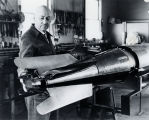 Dr. Goddard with rocket and blast vanes - c. 1940