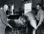 Dr. Goddard & Mansur with upper end of rocket - c. 1940