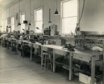 Interior view of Goddard's expanded workshop with employee bench - c. 1941-42