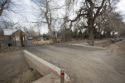House with driveway over acequia