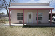 House with a pink porch