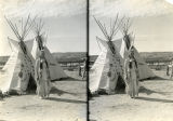 Young woman in front of two Tipis