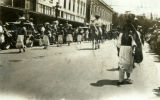 Native American women walk with ceramic pots on their heads in First American Pageant parade